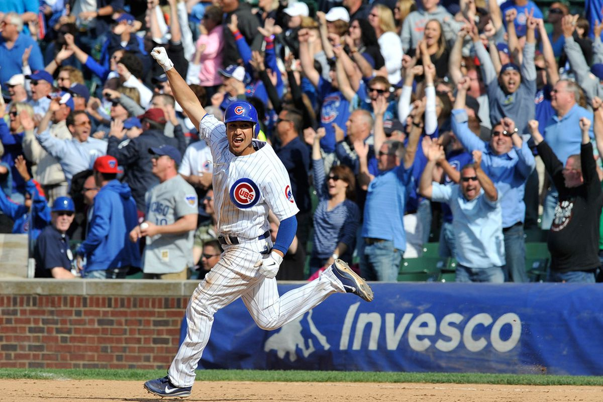 Darwin Barney of the Chicago Cubs hits a walk-off two-run homer against the San Diego Padres at Wrigley Field in Chicago, Illinois. The Chicago Cubs defeated the San Diego Padres 8-6. (Photo by David Banks/Getty Images)