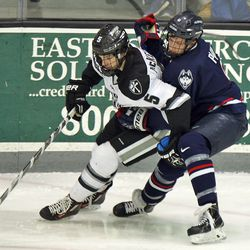 UConn's Shawn Pauly (9) battles with Providence's Kyle McKenzie (5).