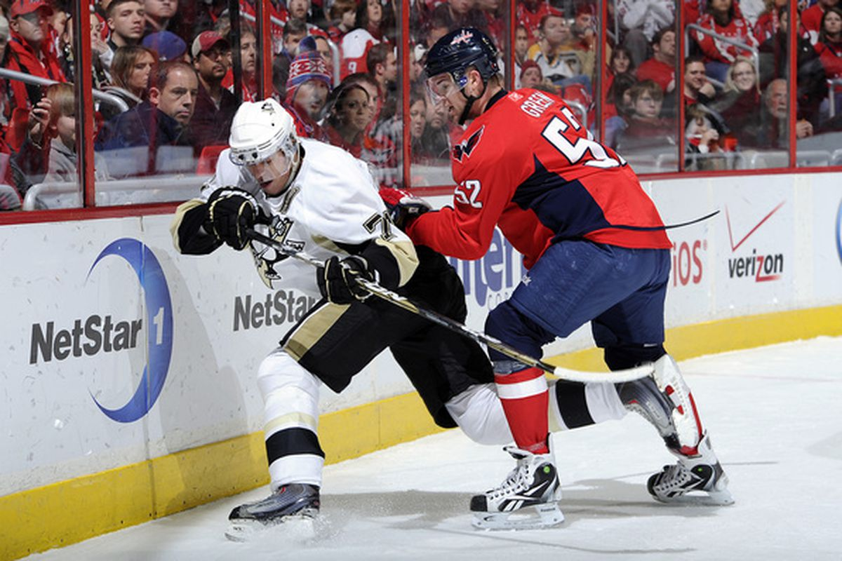 WASHINGTON DC - DECEMBER 23:  Mike Green #52 of the Washington Capitals battles for the puck against Evgeni Malkin #71 of the Pittsburgh Penguins at the Verizon Center on December 23 2010 in Washington DC.  (Photo by Greg Fiume/Getty Images)