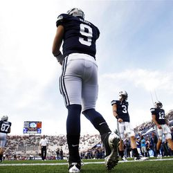 Brigham Young Cougars quarterback Jake Heaps (9) and others on the offense get warmed up prior to the game as they prepare to play Utah Saturday, Sept. 17, 2011 at Lavell Edwards Stadium.