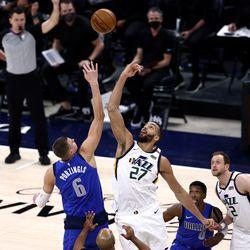 Dallas Mavericks forward Kristaps Porzingis (6) and Utah Jazz center Rudy Gobert (27) tip off the game as the Utah Jazz and the Dallas Mavericks play an NBA basketball game at Vivint Smart Home Arena in Salt Lake City on Wednesday, Jan. 27, 2021.