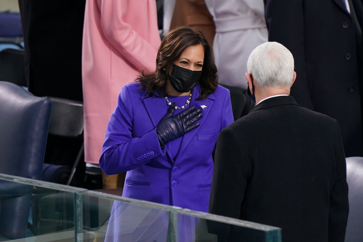 U.S. Vice President Kamala Harris and Mike Pence speak before the inauguration of President Joe Biden on the West Front of the U.S. Capitol on January 20, 2021 in Washington, DC.