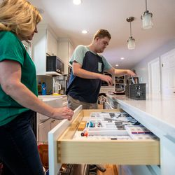 Jennie Dopp, left, and son Jackson put away dishes and silverware in their home in Layton on Friday, June 4, 2021. Jackson Dopp has autism and had been waitlisted for services for people with disabilities for many years, but the end's nowhere in sight.