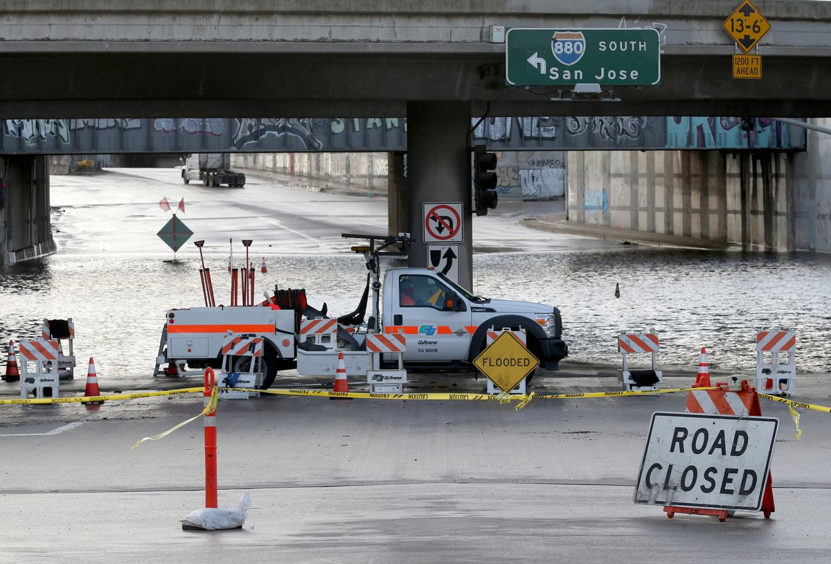 Flooding closes a road in West Oakland, California.