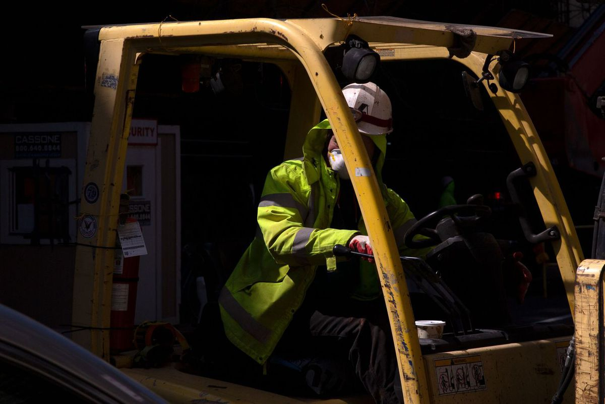 A construction worker operates a lift at a site in Chelsea during the height of the coronavirus outbreak.