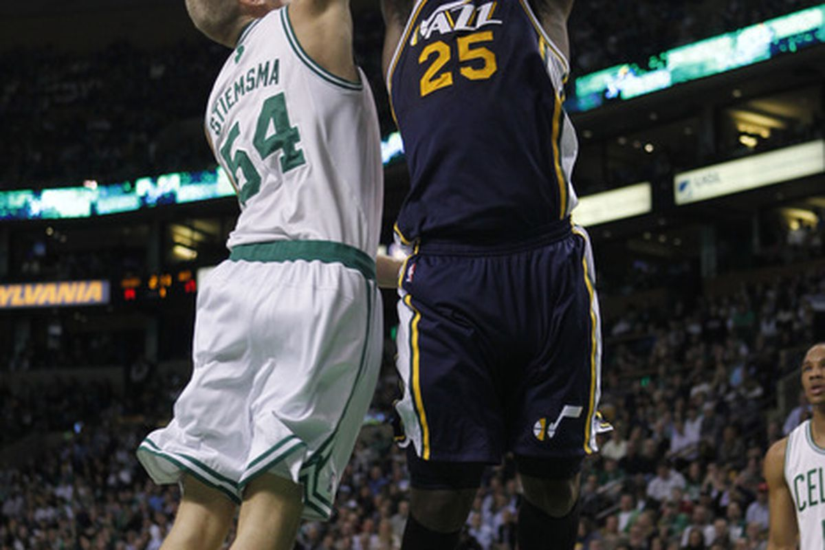 March 28, 2012; Boston, MA, USA; Utah Jazz forward/center Al Jefferson (25) goes for a dunks while guarded by Boston Celtics center Greg Stiemsma (54) during the first quarter at TD Banknorth Garden.   Mandatory Credit: Greg M. Cooper-US PRESSWIRE