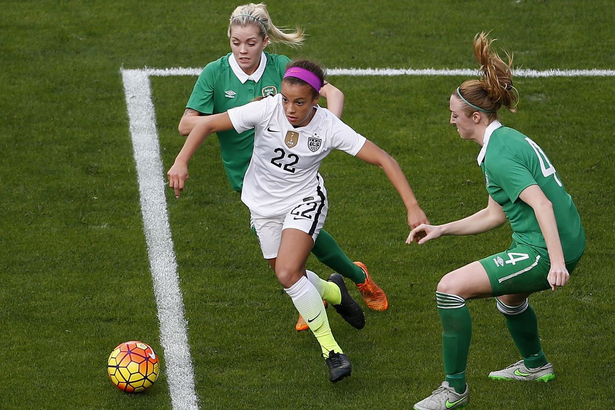 Mallory Pugh weaves between two Ireland defenders in her first cap last month