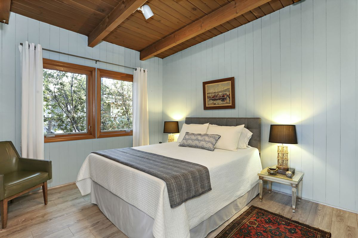 Bedroom with blue planked walls