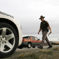 Utah Highway Patrol trooper Carlos Holley makes a stop for improper signaling and unsafe lane travel on I-215 on Thursday, Dec. 13, 2012.