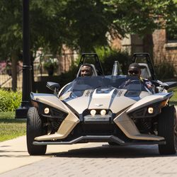 Chicago Bears' running back Tarik Cohen #29 takes wide receiver Taylor Gabriel #18 for a ride in his Polaris Slingshot after arriving for training camp at Olivet Nazarene University in Bourbonnais, Thursday afternoon, July 25, 2019.