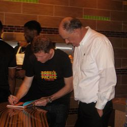 Bobby Flay, signing books, taking pictures with people, probably kissing babies, too.