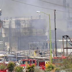 Damaged structures can be seen after an explosion ripped through a gas pipeline distribution center in Reynosa, Mexico near Mexico's border with the United States, Tuesday Sept. 18, 2012. Mexico's state-owned oil company, Petroleos Mexicanos, also known as Pemex said the fire had been extinguished and the pipeline had been shut off but ten people were killed during the incident.