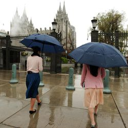 Sister missionaries walk in the snow through Temple Square during the 182nd Annual General Conference for The Church of Jesus Christ of Latter-day Saints in Salt Lake City  Sunday, April 1, 2012.