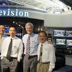 RC Willey CEO Scott Hymas, second from right, with Jaden Offutt, left, Due Trong and Hai Dang Nguyen. The company of 2,400 employees boasts a stable sales force.