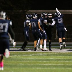 Hunter players celebrate a touchdown during a high school football playoff game against Westlake at Hunter High School in West Valley City on Friday, Oct. 23, 2020.