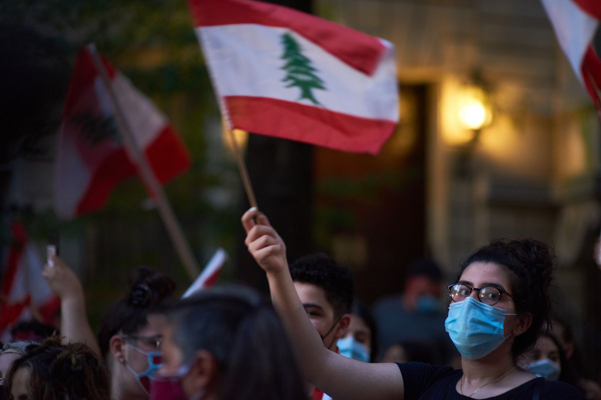 Protesters wave Lebanese flags outside of the Consulate on the Upper East Side, Aug. 10, 2020