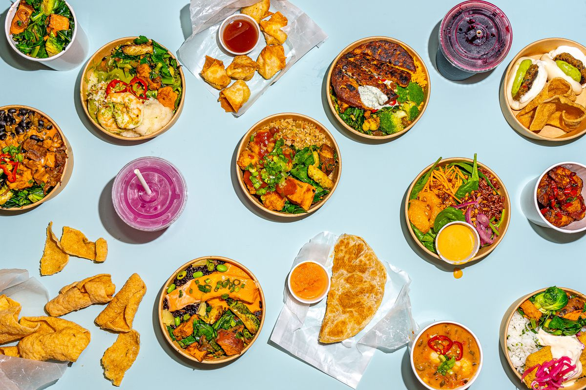 A variety of food items from Fieldtrip's menu, including rice bowls and sides, laid out on a light blue background