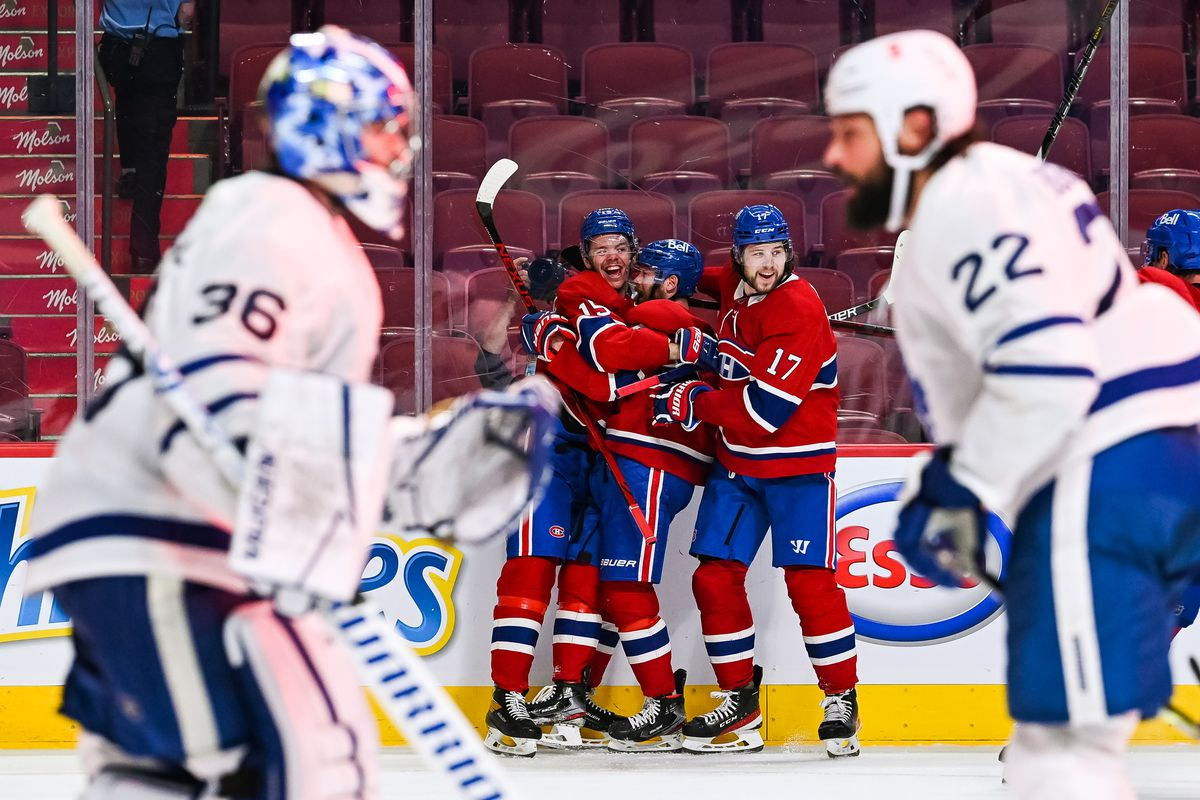 Montreal Canadiens center Jesperi Kotkaniemi (15) celebrates his game winning goal in overtime with his teammates during the NHL Stanley Cup Playoffs first round game 6 between the Toronto Maple Leafs versus the Montreal Canadiens on May 29, 2021, at Bell Centre in Montreal, QC