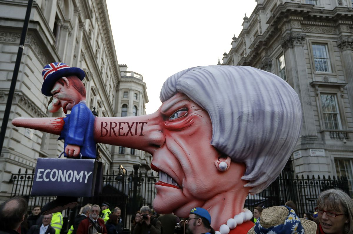 An effigy of British Prime Minister Theresa May passes by Downing Street during the People's Vote anti-Brexit march in London on March 23, 2019.