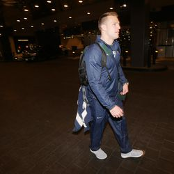 BYU's Taysom Hill and other teamates and coaches arrive at the Hard Rock Hotel and Casino in Las Vegas Nevada, as they prepare to play Utah in the Royal Purple Las Vegas Bowl Tuesday, Dec. 15, 2015.