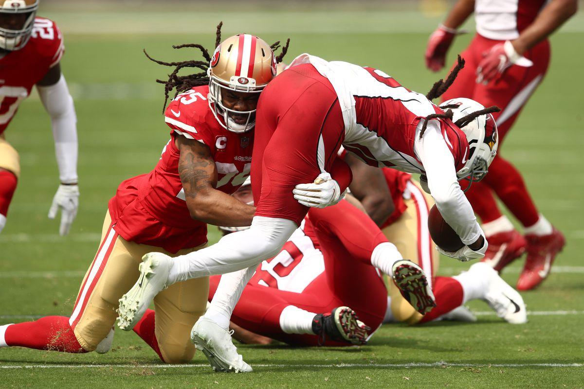 DeAndre Hopkins of the Arizona Cardinals is tackled by Richard Sherman of the San Francisco 49ers at Levi's Stadium on September 13, 2020 in Santa Clara, California.