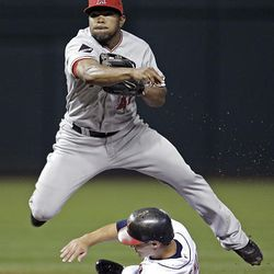 Second baseman Howie Kendrick, top, looks toward first base after getting Cleveland Indians' Grady Sizemore out.