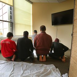 Muslim students pray at the University of Utah's A. Ray Olpin Student Union on Monday, Nov. 16, 2015.