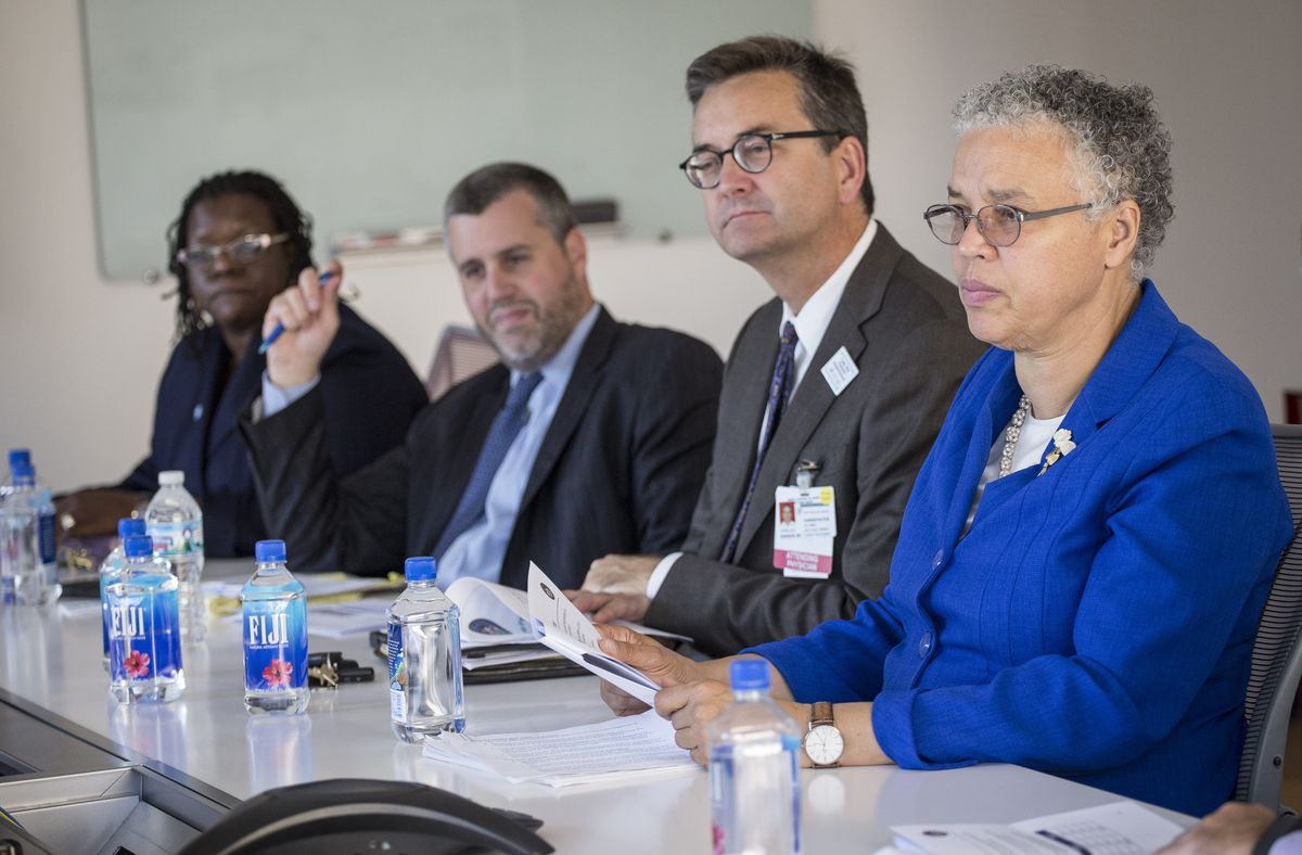 Then Cook County Health CEO John Jay Shannon, second from right, with County Board President Toni Preckwinkle, right, and other county officials in 2015.