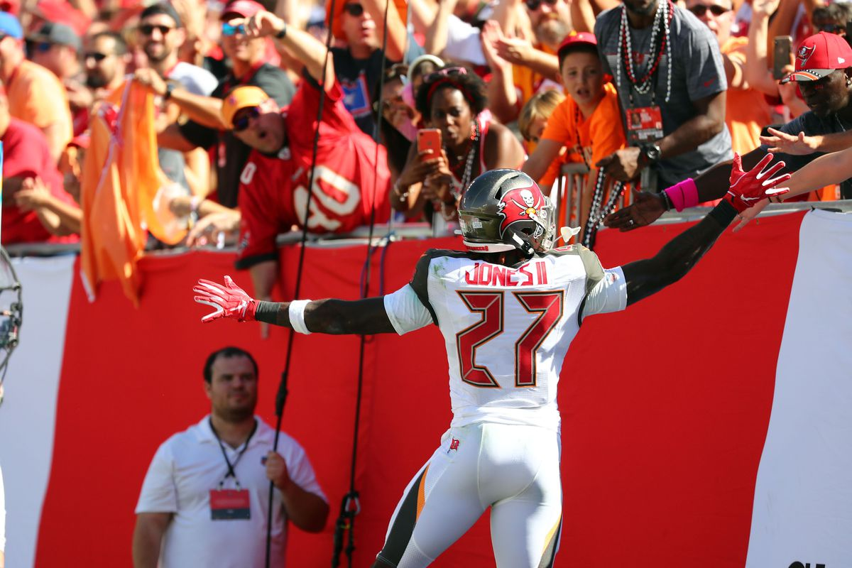 Tampa Bay Buccaneers running back Ronald Jones celebrates with fans after scoring a touchdown against the Arizona Cardinals during the first quarter at Raymond James Stadium.