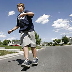 Eric Reese Hudson demonstrates rolling on his heels while wearing Heelys shoes. Some schools have banned the shoe.