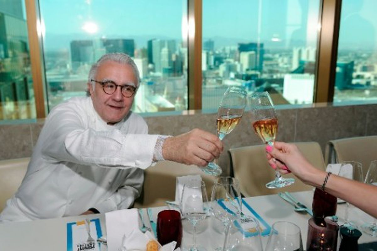 Alain Ducasse clinking Champagne flutes with yours truly.