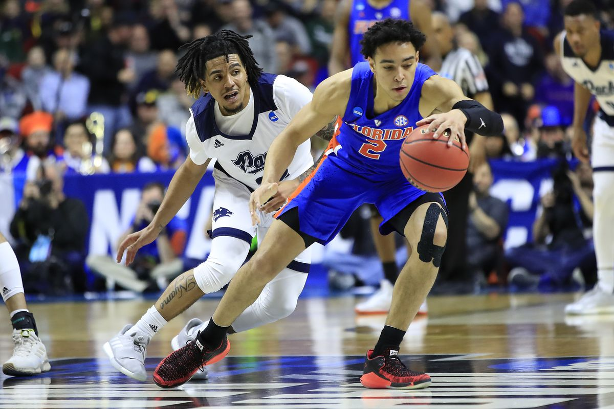 Andrew Nembhard of the Florida Gators is defended by Jazz Johnson of the Nevada Wolf Pack in the second half during the first round of the 2019 NCAA Men's Basketball Tournament at Wells Fargo Arena on March 21, 2019 in Des Moines, Iowa.