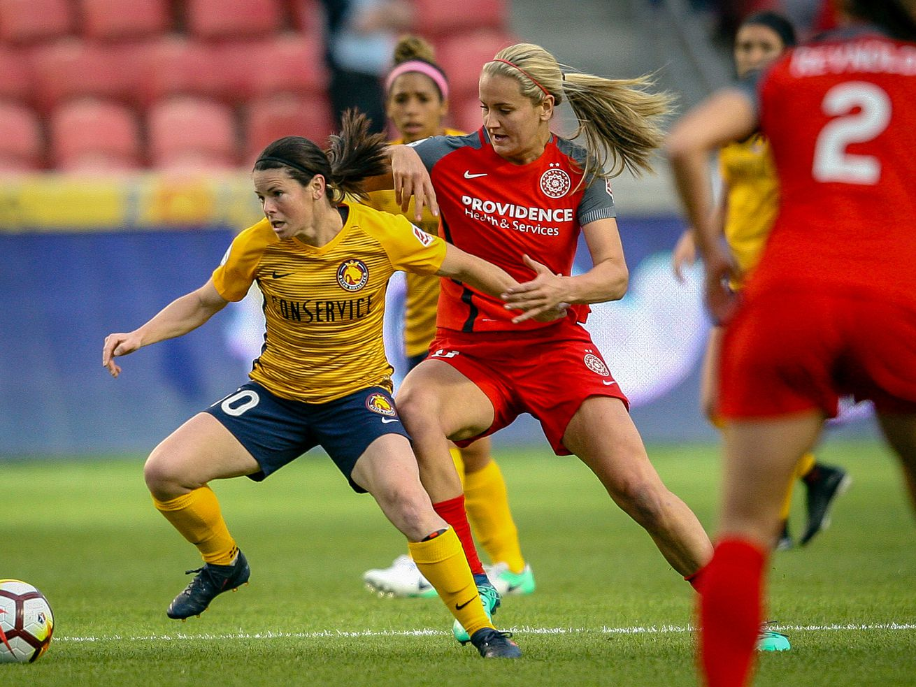 Utah Royals FC midfielder Diana Matheson (10) and Portland Thorns FC midfielder Lindsey Horan (10) fight for control of the ball in the first half as the Utah Royals host the Portland Thorns at Rio Tinto Stadium in Sandy on Saturday, April 28, 2018.