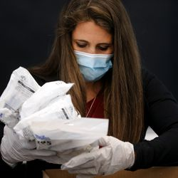Tamara Bell packs N95 masks into boxes at Zagg headquarters in Midvale on Tuesday, April 14, 2020. The company is donating 10,000 of the masks to hospitals, medical professionals and high-risk individuals to help combat the spread of COVID-19 in the communities in which the company operates.