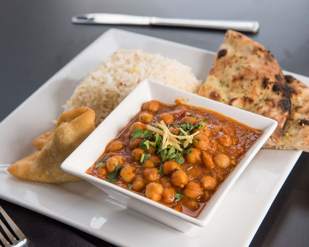 Vegetable samosa with channa masala and garlic naan from Masala Square in Somerville
