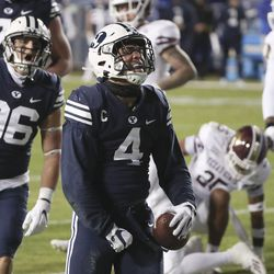 Brigham Young Cougars running back Lopini Katoa (4) celebrates his touchdown against the Texas State Bobcats in Provo on Saturday, Oct. 24, 2020.