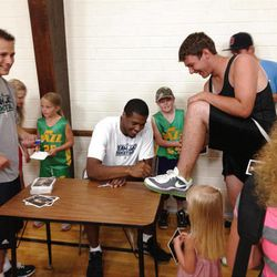 Utah Jazz big man Derrick Favors signs an autograph at a Junior Jazz clinic in Tabiona earlier this summer.