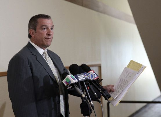Assistant State's Attorney Robert Heilingoetter reads the charges brought against Timothy Trybus.   Kevin Tanaka/For the Sun-Times