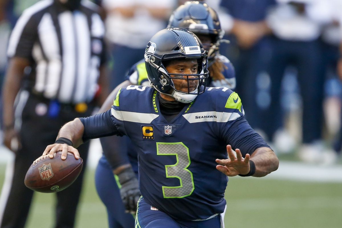 Seattle Seahawks quarterback Russell Wilson throws a touchdown pass against the New England Patriots during the first quarter at CenturyLink Field.