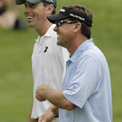 Matt Kuchar, left, and Brandt Jobe are all smiles as they walk to the fifth hole during the final round for the Memorial golf tournament at the Muirfield Village Golf Club in Dublin, Ohio, Sunday, June 5, 2011.