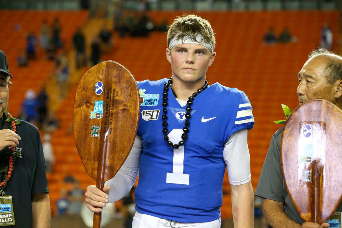 Zach Wilson of the BYU Cougars holds the MVP trophy at the Hawai'i Bowl at Aloha Stadium on December 24, 2019 in Honolulu, Hawaii.