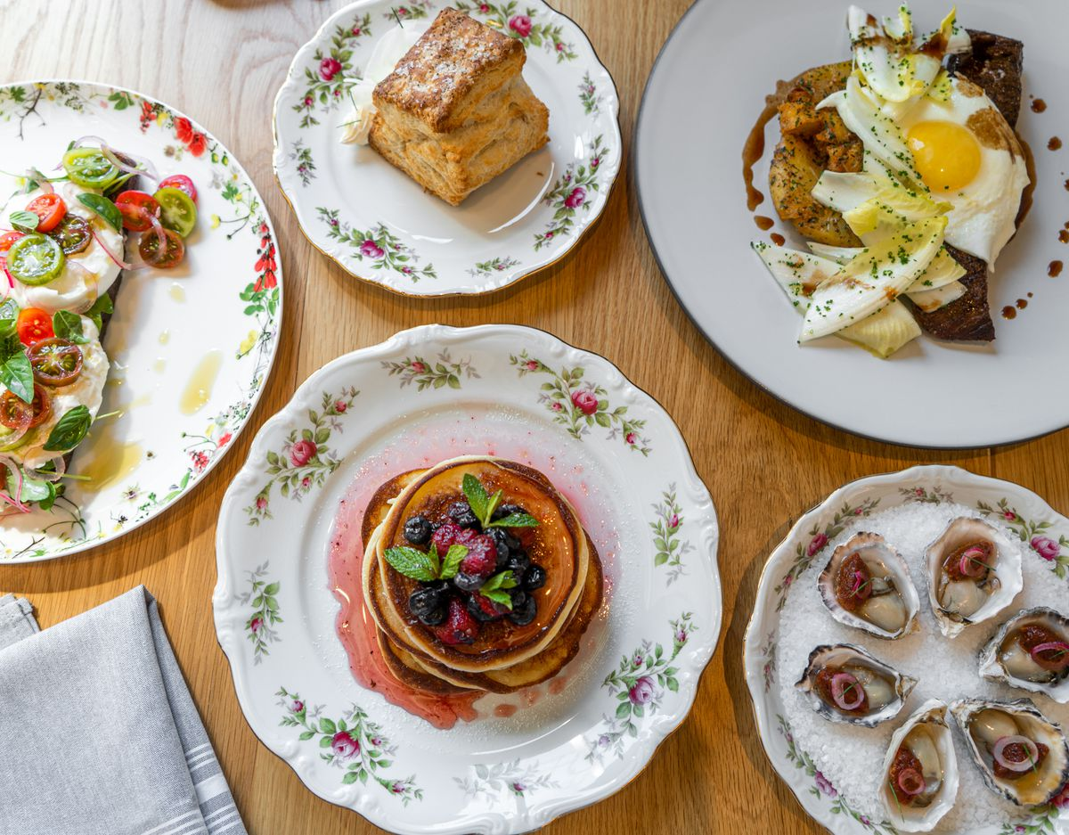 A selection of brunch food on plates.
