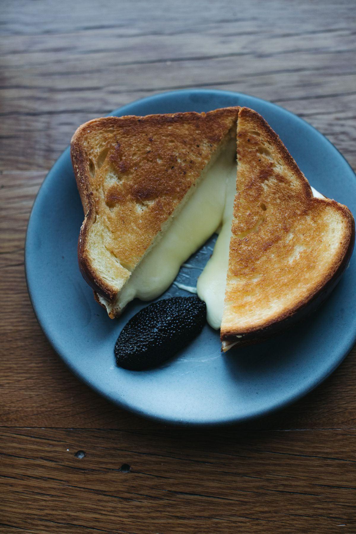 a grilled cheese with caviar on the side