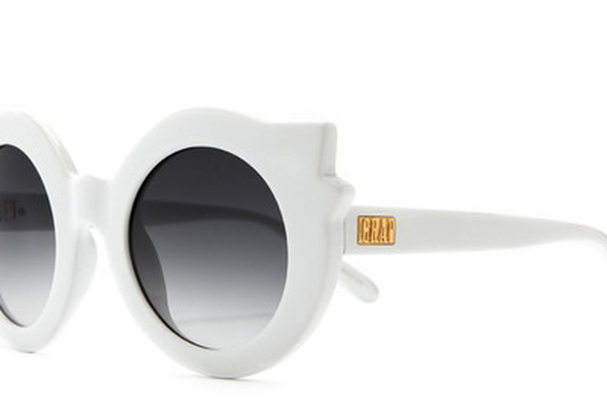 """Hanoi Weekend sunglasses in Gloss White Gradient, <a href=""""http://www.crapeyewear.com/collections/thehanoiweekend/products/the-hanoi-weekend-gloss-white-w-grey-gradient-lenses"""">$56</a> at CRAP Eyewear"""