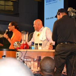 Carla Hall interviewing Zimmern and his sous chef Mike Isabella