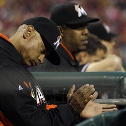 Miami Marlins bench coach Joey Cora cheers during an at-bat in the first inning of a baseball game against the Philadelphia Phillies, Wednesday, April 11, 2012, in Philadelphia.