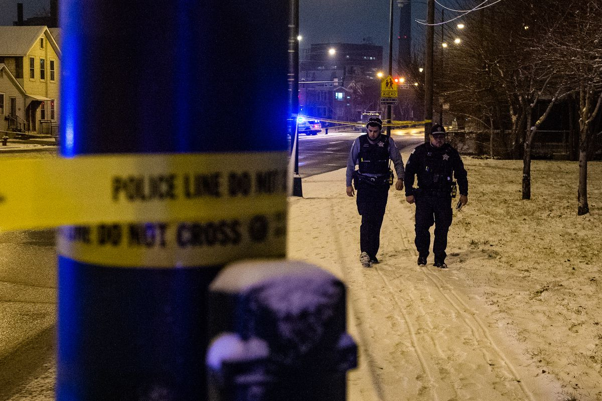 Chicago police investigate the scene where a person was shot Sunday night in the 2000 block of South Canalport, in the Pilsen neighborhood.   Tyler LaRiviere/Sun-Times