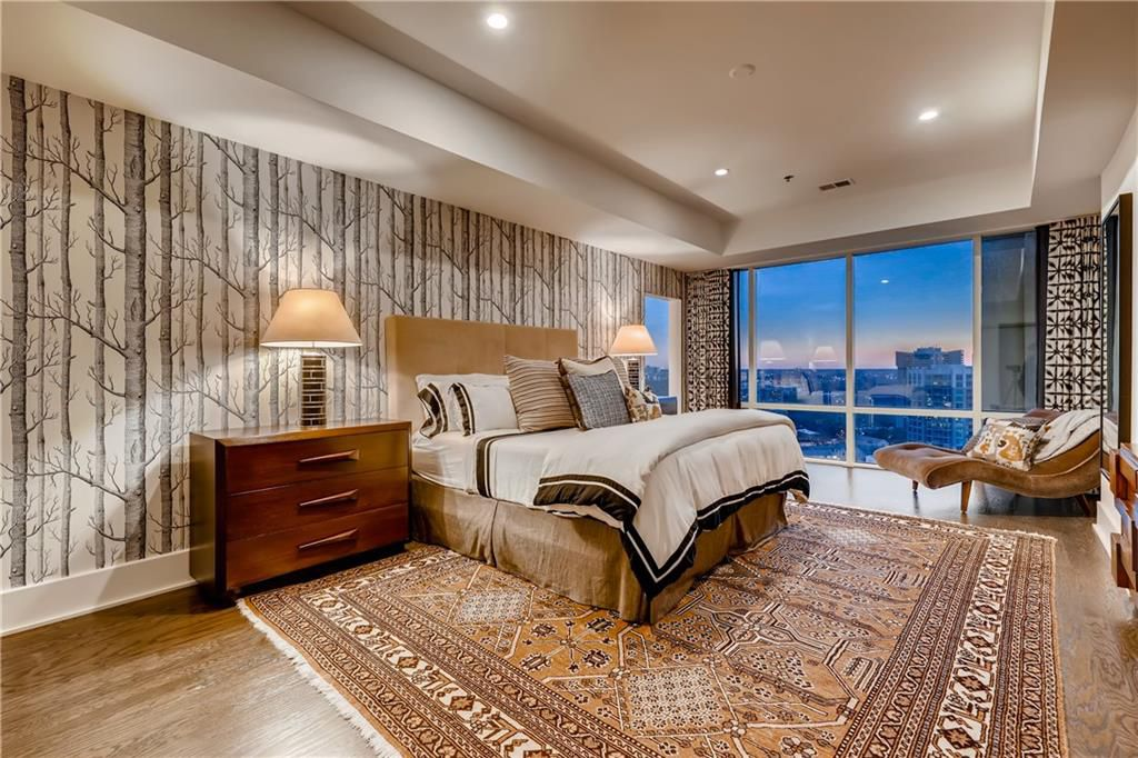A master bedroom with city views.