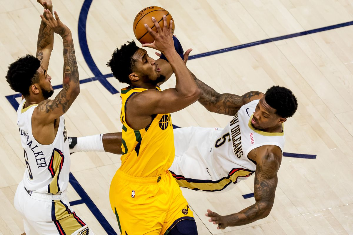 Utah Jazz guard Donovan Mitchell (45) draws the foul from New Orleans Pelicans guard Eric Bledsoe (5) at Vivint Smart Home Arena in Salt Lake City on Tuesday, Jan. 19, 2021.