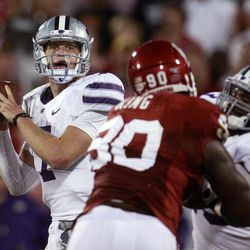 Kansas State quarterback Collin Klein (7) throws as Oklahoma defensive end David King (90) works against Kansas State right tackle Tavon Rooks (73) during the second quarter of an NCAA college football game in Norman, Okla., Saturday, Sept. 22, 2012.